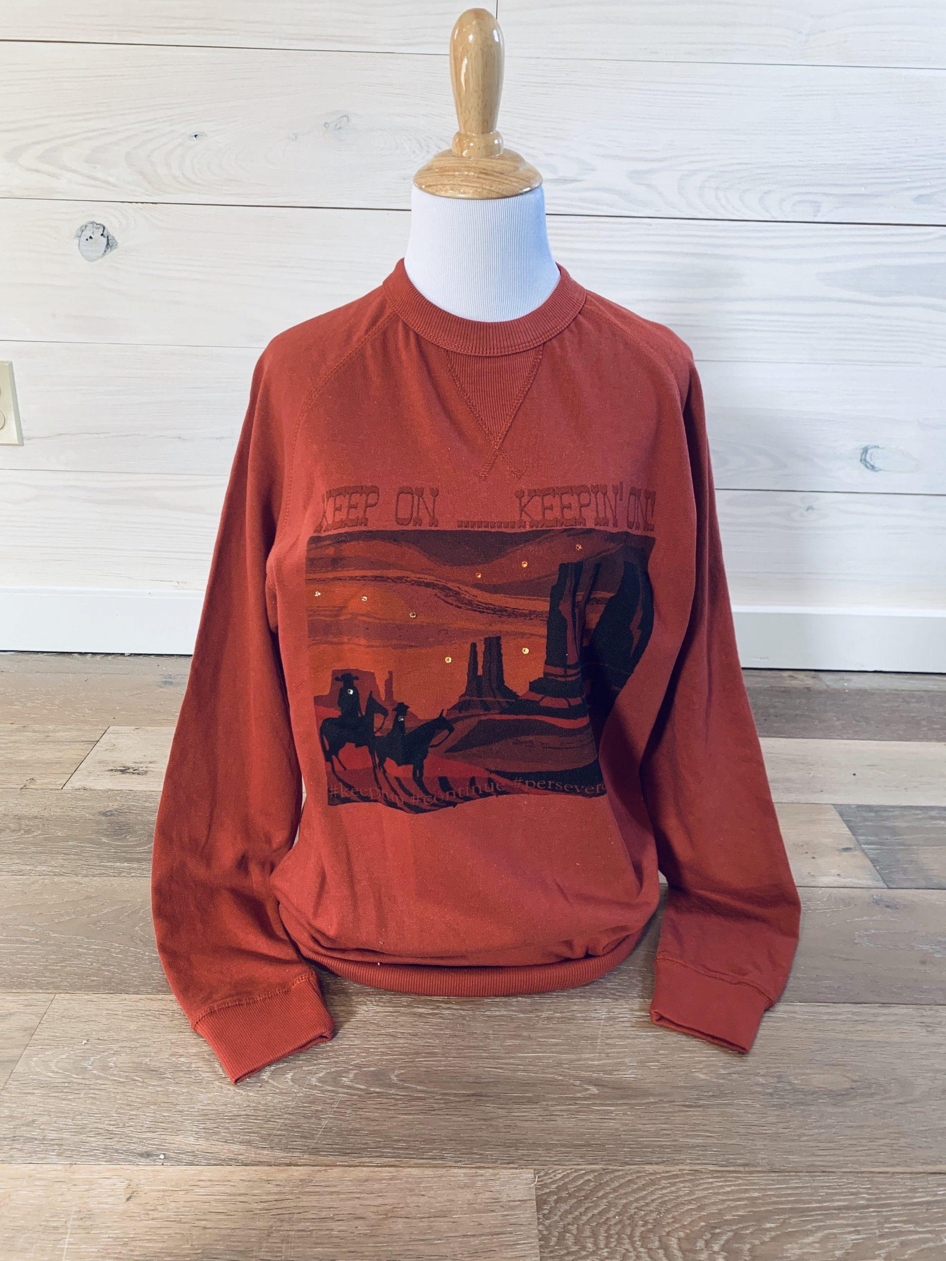 Keep on Keepin On on Rust Sweatshirt